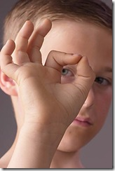 Boy giving okay sign with his hands new habits