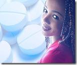 Smiling woman beside white pills uid 1278832