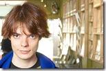 Teenaged boy in record store uid 1181038