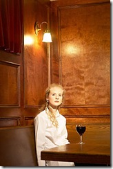 Woman alcoholic drinking glass of red wine in bar