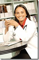 Doctor drink mug of coffee in her office uid 1271749