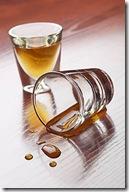 Empty and full shot glasses uid 1344163