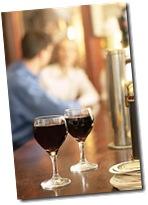 Glasses of red wine on bar uid 1273121