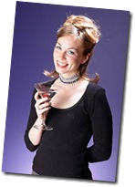 Smiling woman drinking a cocktail uid 1180767