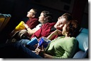 Group of teenagers watching movie in a dark theater uid 1176402