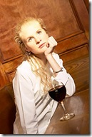 Woman drinking glass of red wine in bar uid 1273142