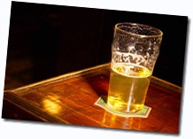 Half a pint of beer on bar table
