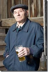 elderly man drinking glass