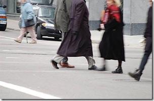 Blur of walking people crossing city street