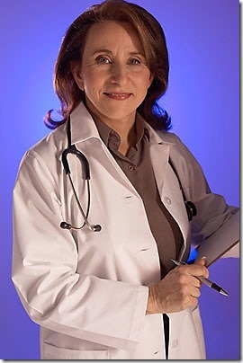 Doctor with stethoscope around her neck holding clipboard uid 1173327